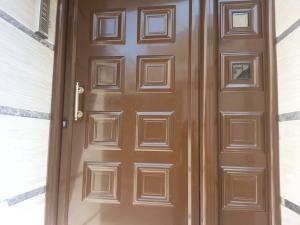 Εξωτερική Πόρτα ασφαλείας με επένδυση αλουμινίου